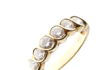 Yellow metal and six stone diamond ring, with guilloche...