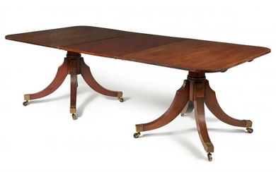 A mahogany triple pedestal extending dining table, circa 1800 and later
