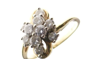 18ct gold and diamond cluster ring, in Modernist style...