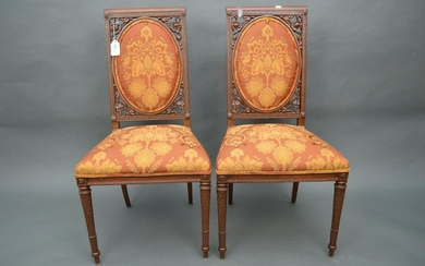 Pair of French Empire style side chairs. The open