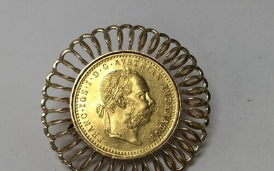 A 1915 Austrian 1 Ducat (23ct gold coin) with a 14ct gold br...