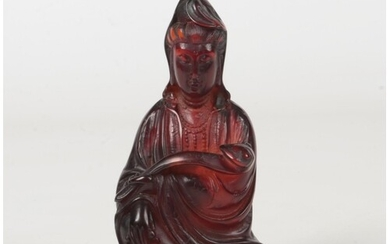 A 19th century Chinese carved amber figure of Guanyin seated...