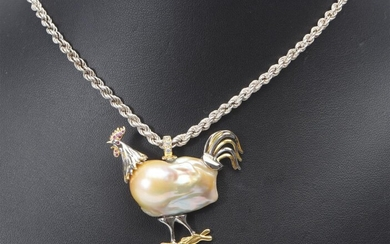 A BAROQUE PEARL ROOSTER PENDANT IN SILVER GILT (45X45MM), TO AN ITALIAN ROPE TWIST CHAIN IN STERLING SILVER, TOTAL LENGTH 250MM