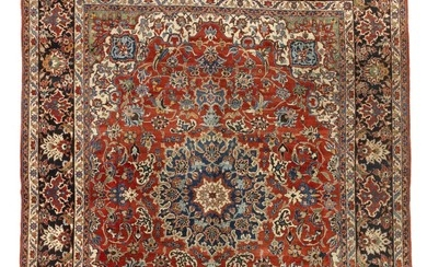 A Baktiari carpet, Persia. Stylized medallion design on a red field of large decorative palmettes, enwtined branches and foliage. 1940–1950. 405×329 cm.