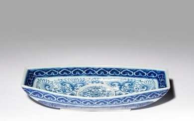 A CHINESE BLUE AND WHITE INGOT-SHAPED CUP STAND 19TH CENTURY...