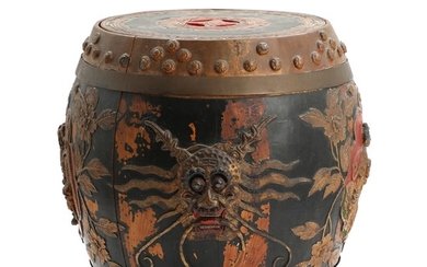 A Chinese barrel shaped paint wood rice container, decorated in relief. C. 1900. H. 39 cm.