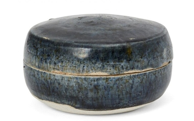 A Chinese blue-glazed pottery cosmetic box, Tang dynasty, of circular...