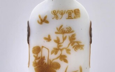 A Chinese carved overlay snuff bottle