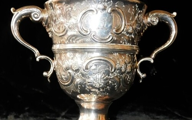 A GEORGIAN IRISH SILVER LOVING CUP Having twin handles, fine...