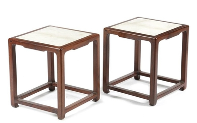 A PAIR OF CHINESE HARDWOOD STOOLS IN MING...