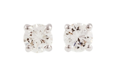 A PAIR OF DIAMOND STUD EARRINGS, the brilliant cut diamonds ...