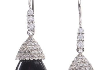 A PAIR OF ONYX AND DIAMOND EARRINGS