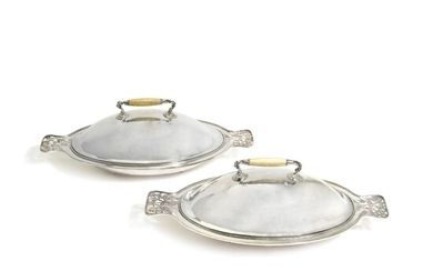 A PAIR OR GUILD OF HANDICRAFT SILVER-PLATED COPPER VEGETABLE DISHES AND COVERS, DESIGNED BY C. R. ASHBEE, CIRCA 1900