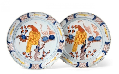 A Pair of Dutch Delft Pancake Plates, 18th century, painted...