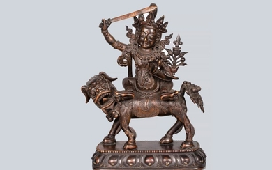 A Patinated Bronze Figure of Manjushri riding a Dragon, China, 18th Century.