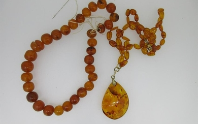 A Russian amber pendant on necklace together with a