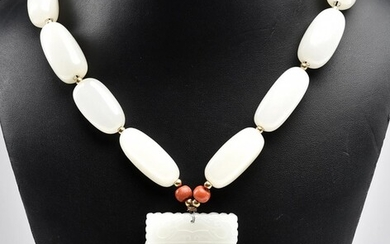 A TREATED JADE RECTANGULAR PENDANT AND NECKLACE WITH CORAL DETAIL, TOTAL LENGTH 530MM