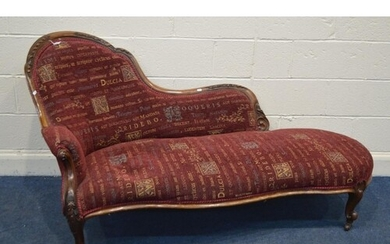 A VICTORIAN WALNUT CHAISE LONGUE, with a serpentine front, o...