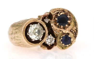 A diamond and sapphire ring set with an old brilliant-cut, a single cut and an...