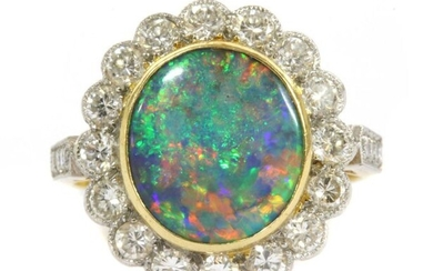 A gold boulder opal and diamond cluster ring, an oval...