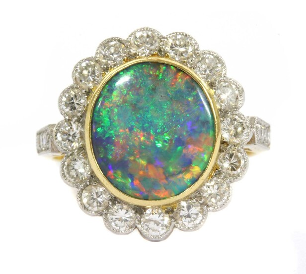 A gold boulder opal and diamond cluster ring