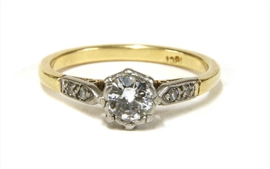 A gold single stone diamond ring