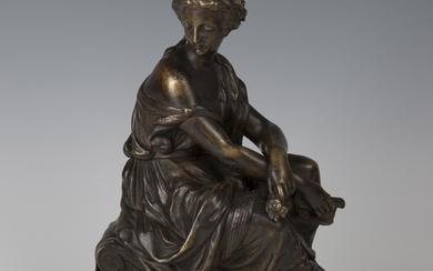 A late 19th century French brown and gilt patinated cast bronze figure of a seated Classical maiden