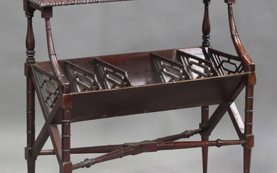 A late 20th century Regency reproduction stained hardwood book trough with fretwork divides, on turn