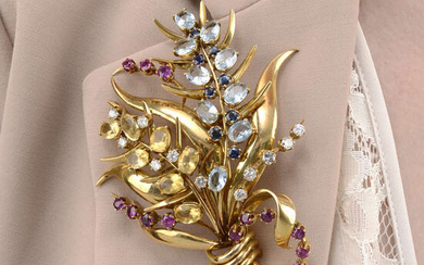 A mid 20th century vari gem floral spray dress clip.