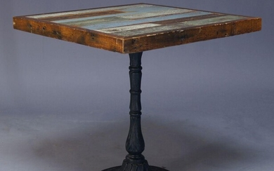 A painted wood and cast iron side table, of recent...