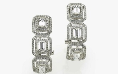 A pair of hoop earrings with brilliant cut diamonds and
