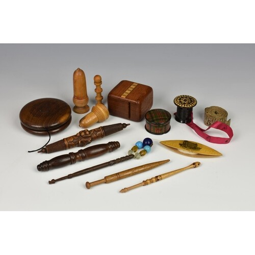 A small collection of antique treen sewing accessories, to i...
