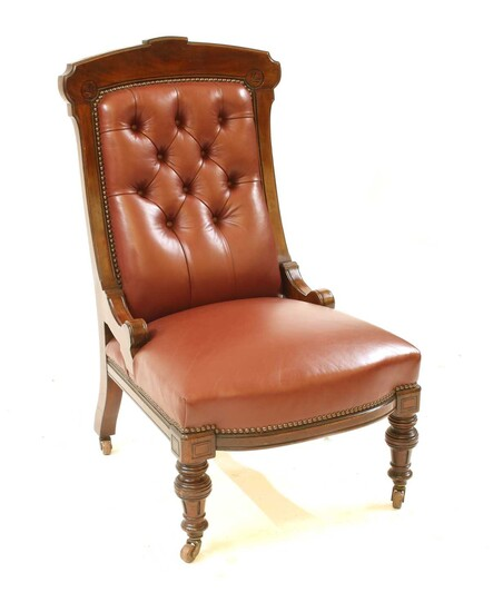 A walnut frame red leather button backed library chair