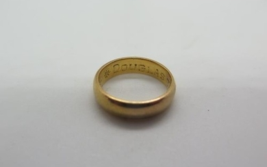 A yellow gold ring, engraved but not hallmarked, size J, app...