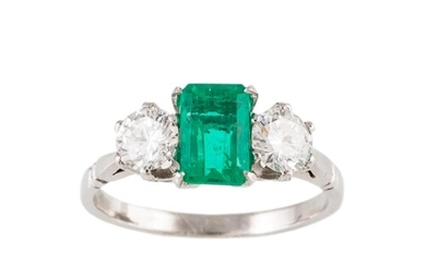 AN EMERALD AND DIAMOND THREE STONE RING, the octagonal emera...