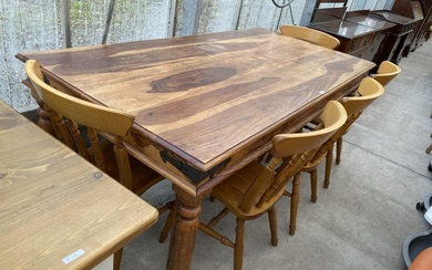 AN INDONESIAN WOOD DINING TABLE AND FIVE BEECH DINING CHAIRS