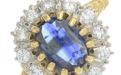 An 18ct gold oval-shape sapphire and brilliant-cut diamond cluster ring.