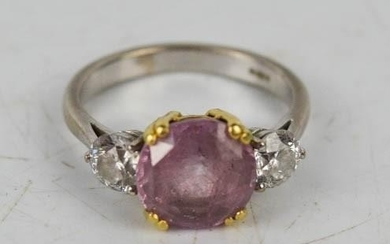 An 18ct white gold, pink sapphire and diamond ring, each dia...