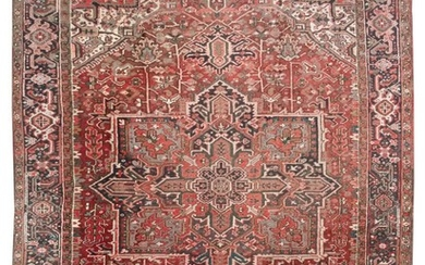 """ORIENTAL RUG: HERIZ 9'4"""" x 12'5"""" Dark red field contains a gabled medallion in faded shades of charcoal, red and ivory. Ivory subfie."""