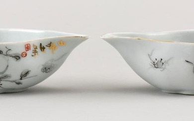 PAIR OF CHINESE PORCELAIN WINE CUPS In pear shape, with grisaille decoration of pomegranates and gilt highlights. Seal mark at spout...