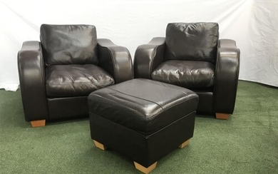 PAIR OF LEATHER CLUB ARMCHAIRS with shaped arms, on squat su...