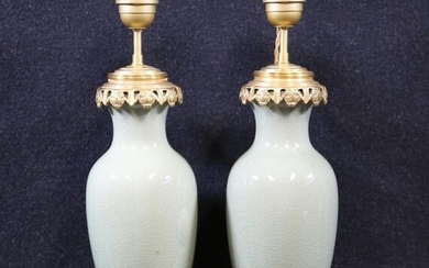 Pair of celadon porcelain lamps, gilt bronze mounting. Height without...
