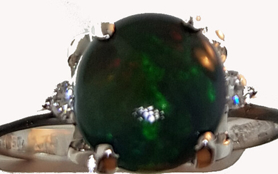 Ring in white gold 750°/°°° with a night opal cabochon of approx. 2 ct. with two diamonds, Finger size 52, Gross weight: 2,89g