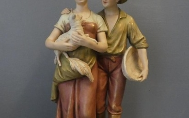 Royal Dux group ornament of a loving young couple holding a ...