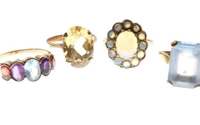Three 9ct gold dress rings, together with a yellow...