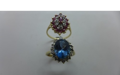 A 9ct gold oval ruby and diamond cluster ring set with thirt...