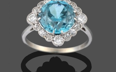 A Blue Zircon and Diamond Cluster Ring, the round cut...