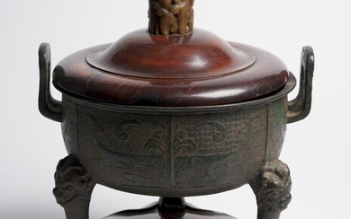A CHINESE ARCHAISTIC BRONZE 'DING' CENSER WITH JADE-EMBELLISHED HARDWOOD LID QING DYNASTY (1644-1912), 18TH CENTURY OR EARLIER