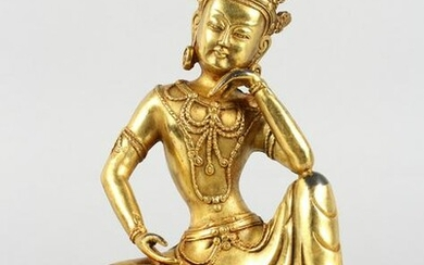 A CHINESE GILT BRONZE FIGURE OF A SEATED DEITY. 8ins