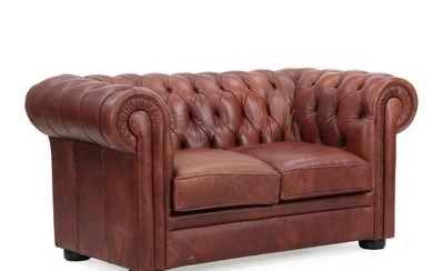A Chesterfield two-seater with brown leather cover. Of recent manufacture. L. 165 cm.